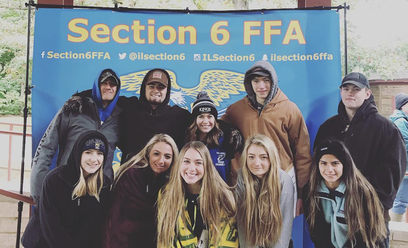 FFA Members standing in front of Section 6 FFA sign