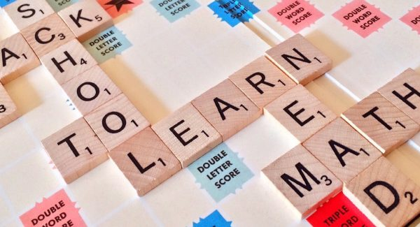 scrabble pieces spelling LEARN